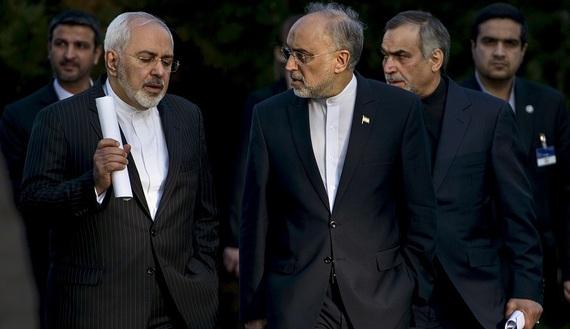 Iranian Foreign Minister Javad Zarif (L) talks with Head of the Iranian Atomic Energy Organization Ali Akbar Salehi
