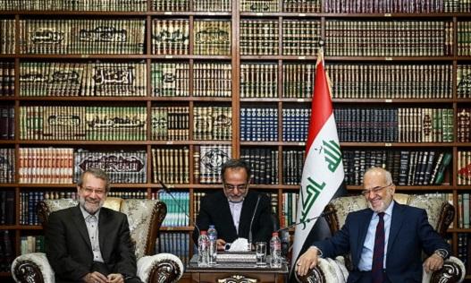 Ali Larijani (left) in Baghdad