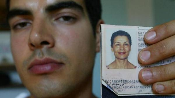 Stephan Hachemi, Zahra Kazemi's son hold his mother identification card