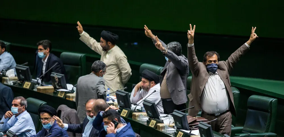 MPs at the Iranian parliament gesturing two with their hands to convince others to vote for controversial Internet bill- photo by ISNA - Alireza Masoumi